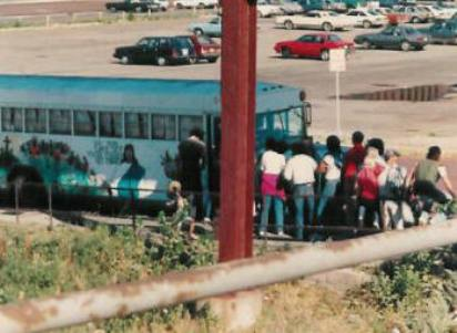 People line up for meals at the Hobo Bus.