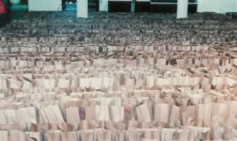 Thousands of grocery bags are lined up ready to be filled with food for the Holiday GiveAways.