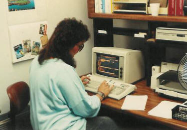 Sue Hastings enters data in the custom database developed using DOS 2.0 in 1986.